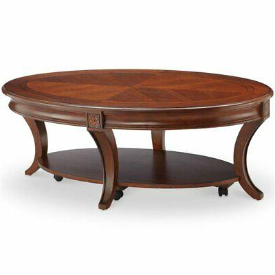 oval coffee table with casters in cherry